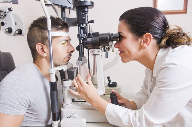 Young boy in an optical scans machine exams his vision and optometry